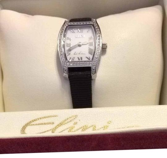 Preload https://item4.tradesy.com/images/white-face-with-black-band-elini-diamond-watch-2077673-0-0.jpg?width=440&height=440