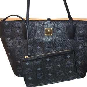MCM Tote in Black with gold hardware.