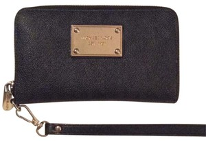 Michael Kors Wristlet in Black And Gold