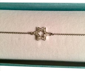 Other 14k white gold bracelet with approximately .10 diamond star