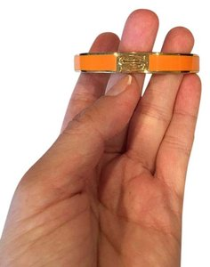 Trina Turk Gold and Orange Cuff with the letter