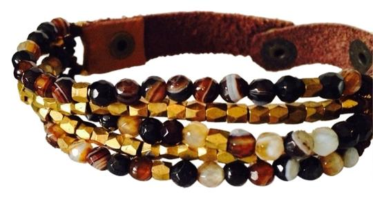 Preload https://item2.tradesy.com/images/panacea-cache-shades-of-blackbrown-blackbrown-faceted-bead-leather-bracelet-2078806-0-0.jpg?width=440&height=440
