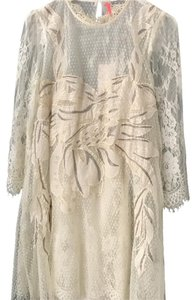Free People short dress Cream with silver detailing on Tradesy