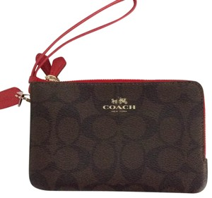 Coach Wristlet in brown/True Red