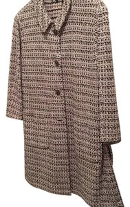 St. John St. John thigh length jacket in brown and beige tweed. 3/4 sleeves. Perfect for work over black skinny pants. very chic and professional