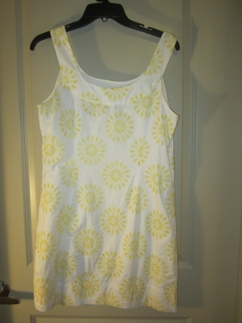 New York & Company short dress White with Yellow Eyelet And on Tradesy