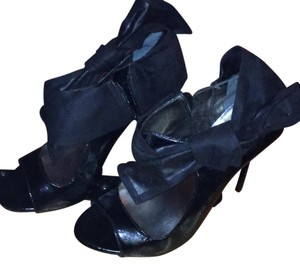 Carlos mantana black patent leather with suede bow on side and inside zipper Platforms