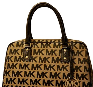 Michael Kors Satchel in Beige jaquard fabric with black MK logo, black handles, gold tone hardware and hang tag