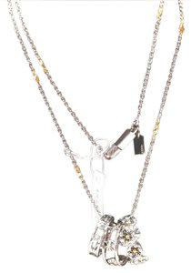 Coach coach long multi tone and ring necklace