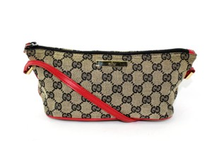 Gucci Canvas Monogram Wristlets Satchel in Black and Red