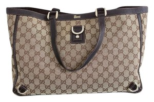 Gucci Monogram Canvas Leather Luxury Tote in Brown