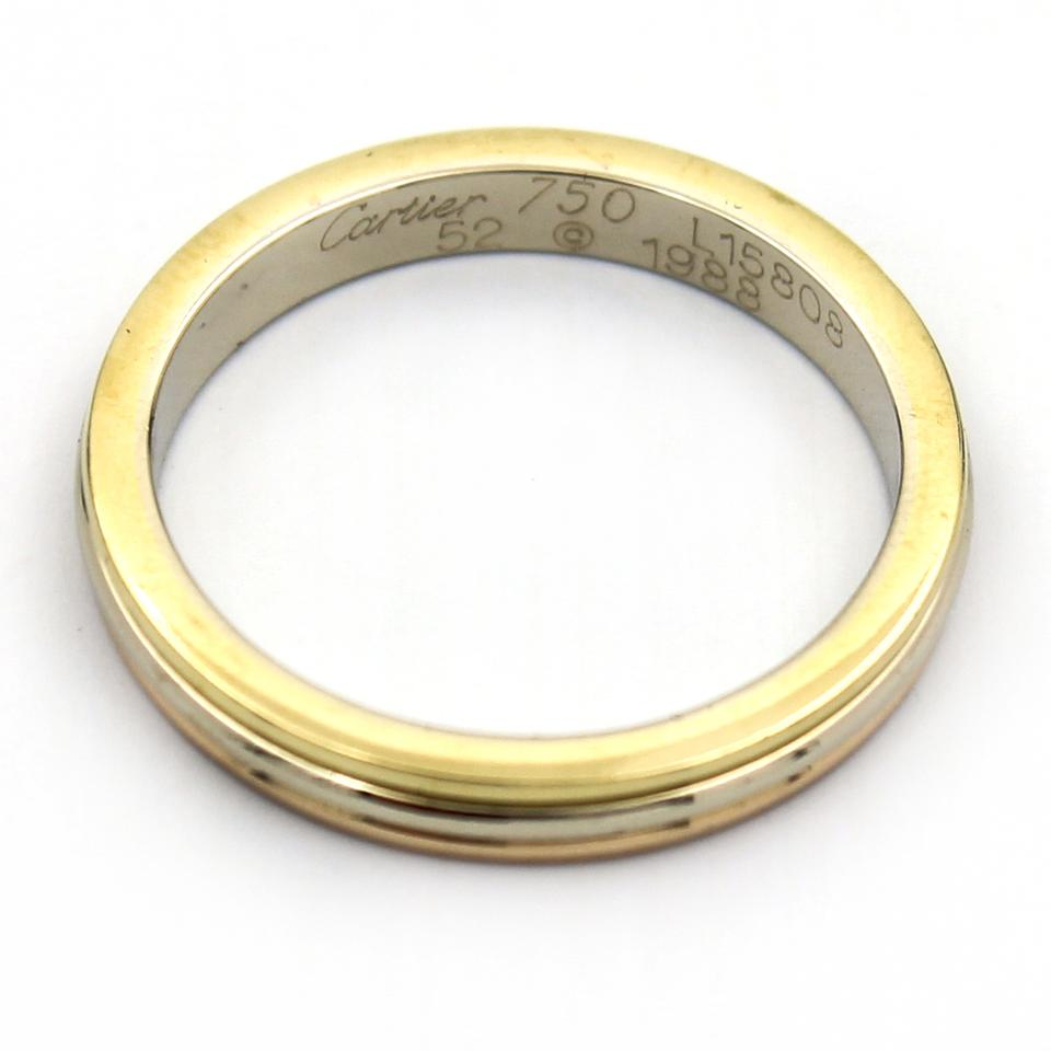 cartier wedding band Men s 18K yellow white and rose gold Cartier Trinity Wedding band Includes box and