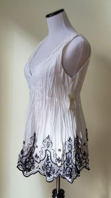 Other short dress White Selé Grecian With Embroidered Flowers At The Bottom Of on Tradesy
