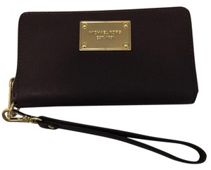 Michael Kors Michael Kors Wristlet - brown leather - excellent used condition