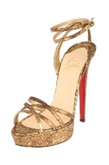 Preload https://item1.tradesy.com/images/christian-louboutin-bronze-passiflore-ostrich-ankle-strap-platform-heels-gold-395-sandals-size-us-95-20818700-0-0.jpg?width=440&height=440