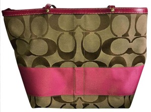Coach Tote in tan with brown c's pink stripe and pink lining
