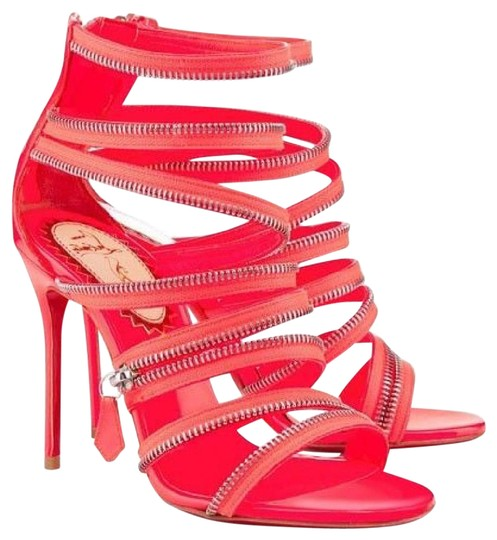 Preload https://item1.tradesy.com/images/christian-louboutin-pink-coral-unzip-booty-20ans-patent-strappy-zip-heels-booties-375-sandals-size-u-20819025-0-1.jpg?width=440&height=440