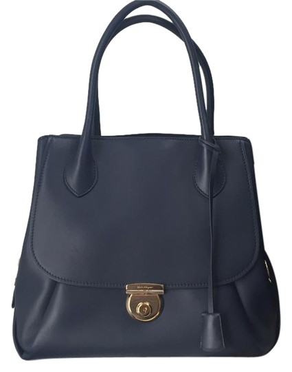 Preload https://img-static.tradesy.com/item/20820456/salvatore-ferragamo-fiamma-ornament-lock-bnwt-oxford-blue-leather-tote-0-3-540-540.jpg