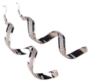 Other $150 White gold plated twist earrings