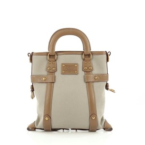 Louis Vuitton Toile Leather Satchel in Brown