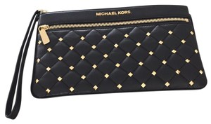 Michael Kors Wristlet in Black leather/Gold pyramid studs