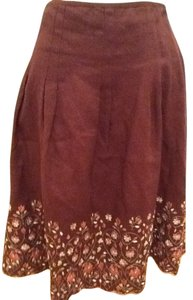 Ann Taylor Skirt Chocolate brown with design on bottom of skirt rust and green