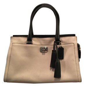 Coach Tote in Two-toned black and mushroom leather.