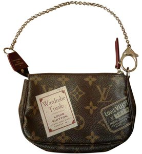 Louis Vuitton Trunks Illustre Prints Clutch Monogram Wristlet in Brown
