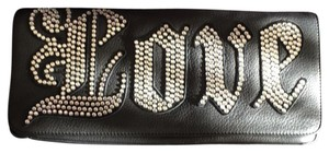 Charm and Luck black leather Clutch