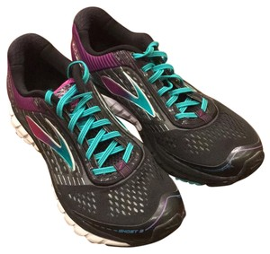 Brooks black with green and purple accents Athletic