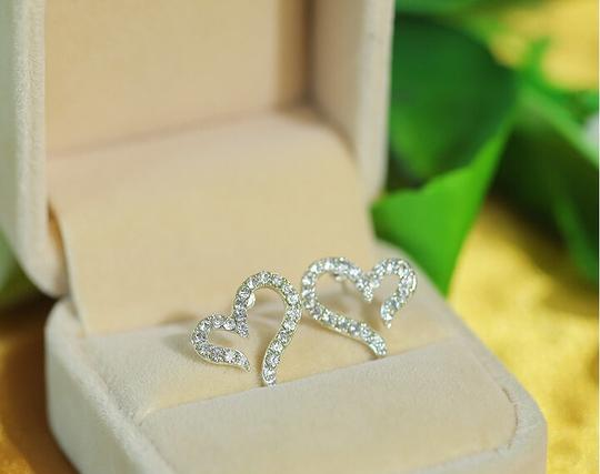 Preload https://item2.tradesy.com/images/silver-bogo-free-any-two-listing-rhinestone-heart-free-shipping-earrings-2084281-0-0.jpg?width=440&height=440