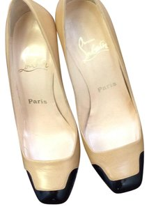 Christian Louboutin Beige and black patent leather. Pumps