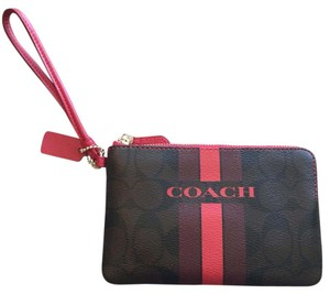 Coach Wristlet in brown and red