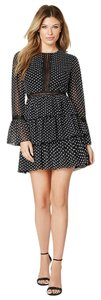 bebe short dress Black Polka Dot Tiered Night Out Little on Tradesy