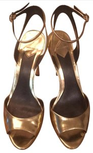 Brian Atwood Gold Mirrored Platforms