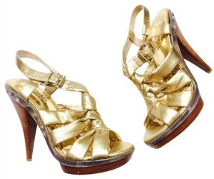 Michael Kors Gold Pumps