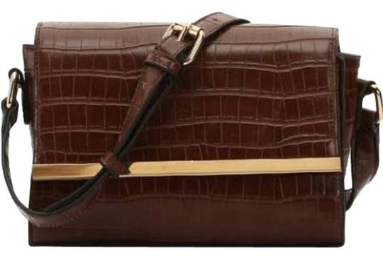 Preload https://img-static.tradesy.com/item/20854489/kelly-and-katie-embossed-cognac-faux-leather-cross-body-bag-0-1-540-540.jpg