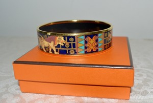 Hermès Hermes Paris Enamel Lion Motif Gold Tone Bangle Bracelet 70