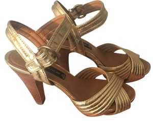 Steven by Steve Madden gold Sandals
