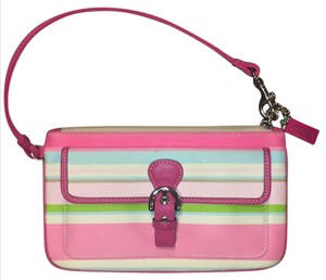 Coach Wristlet in Pink leather trim; multicolored fabric