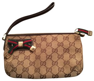 Gucci Wristlet in brown leather and brown/beige canvas