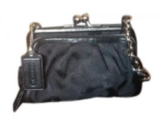 Preload https://item5.tradesy.com/images/coach-chain-strap-3-compartment-black-cloth-shoulder-bag-20869-0-0.jpg?width=440&height=440