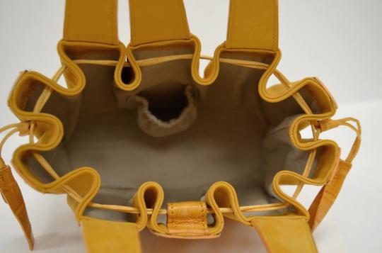 Domenico Vacca Structured Pumpkin Shaped Magnetic Tab Closure Drawstring On Sides Double Handle Tote in Gold Image 5