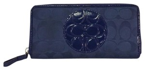 Coach never used blue patent leather and nylon zip around long wallet