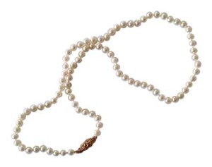 Other real pearl with 14kt clasps