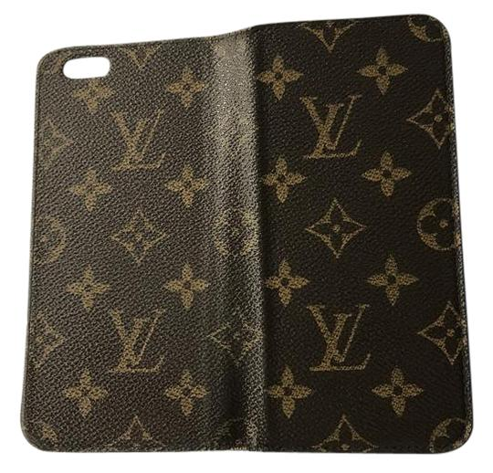 free shipping b262f 27f35 Louis Vuitton Brown with Traditional Print. Inside Cover Is Blue. No  Visible Wear and Tear. Phone Can Easily Be Removed 6 / 6s Plus Folio  Monogram ...