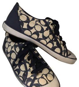 Coach Navy and white, with gold accents. Athletic