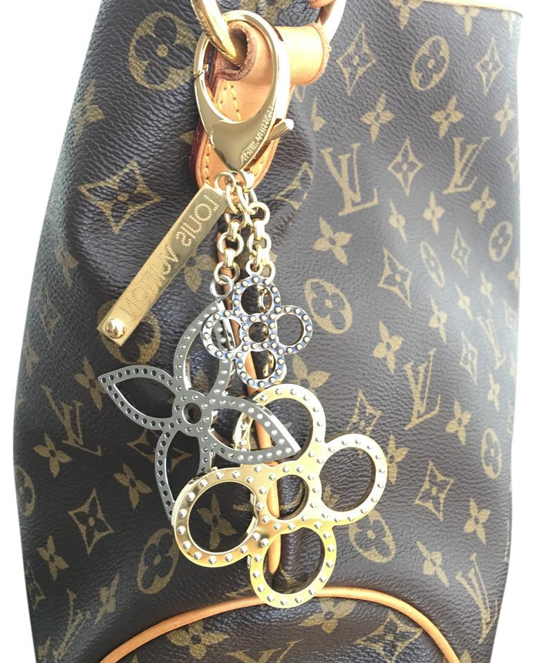 Louis Vuitton Authentic Used Tapage Bag Charm M65090 W Box