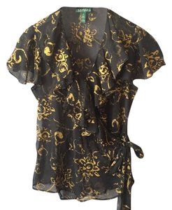 Ralph Lauren Top Sheer black blouse with gold swirl pattern. Frilled vee neckline. Wraps at waste and ties at left side. Short sleeves are split yet overlap at top of shoulder.