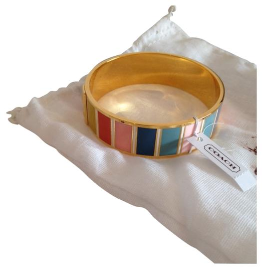 Preload https://item1.tradesy.com/images/coach-gold-and-array-of-tiles-bangle-bracelet-2089210-0-0.jpg?width=440&height=440